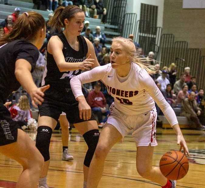 Oregon City's Brooke Bullock is cut off by Tigard's Campbell Gray (left) and Delaney Leavitt (center). (Photo by Tamara Peyton)