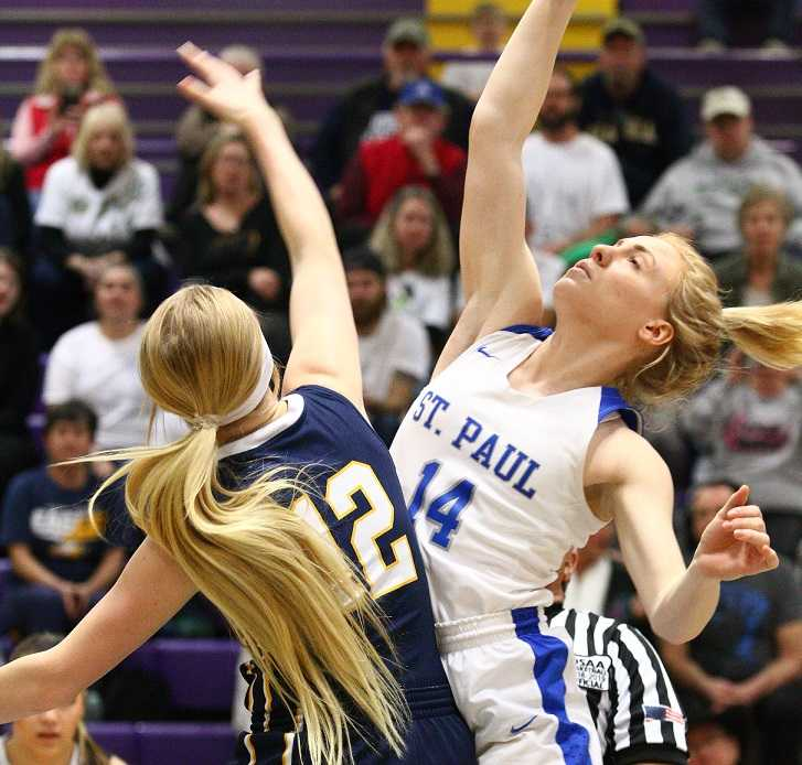 St. Paul's Isabelle Wyss (14) goes up against Joseph's Haley Miller (12) on Thursday. (NW Sports Photography)