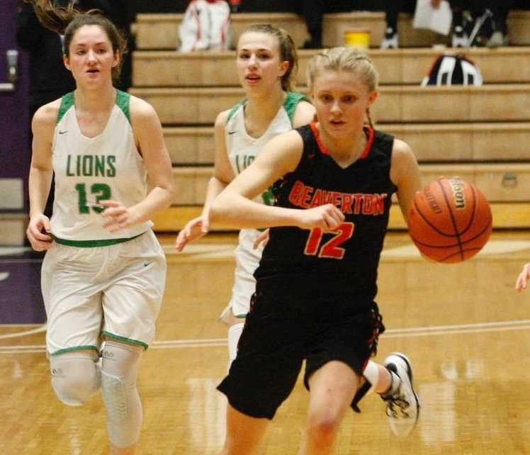Beaverton's Mary Kay Naro races up the court past West Linn's Elisabeth Dombrow (13) and Cami Fulcher. (Photo by Norm Maves Jr.)