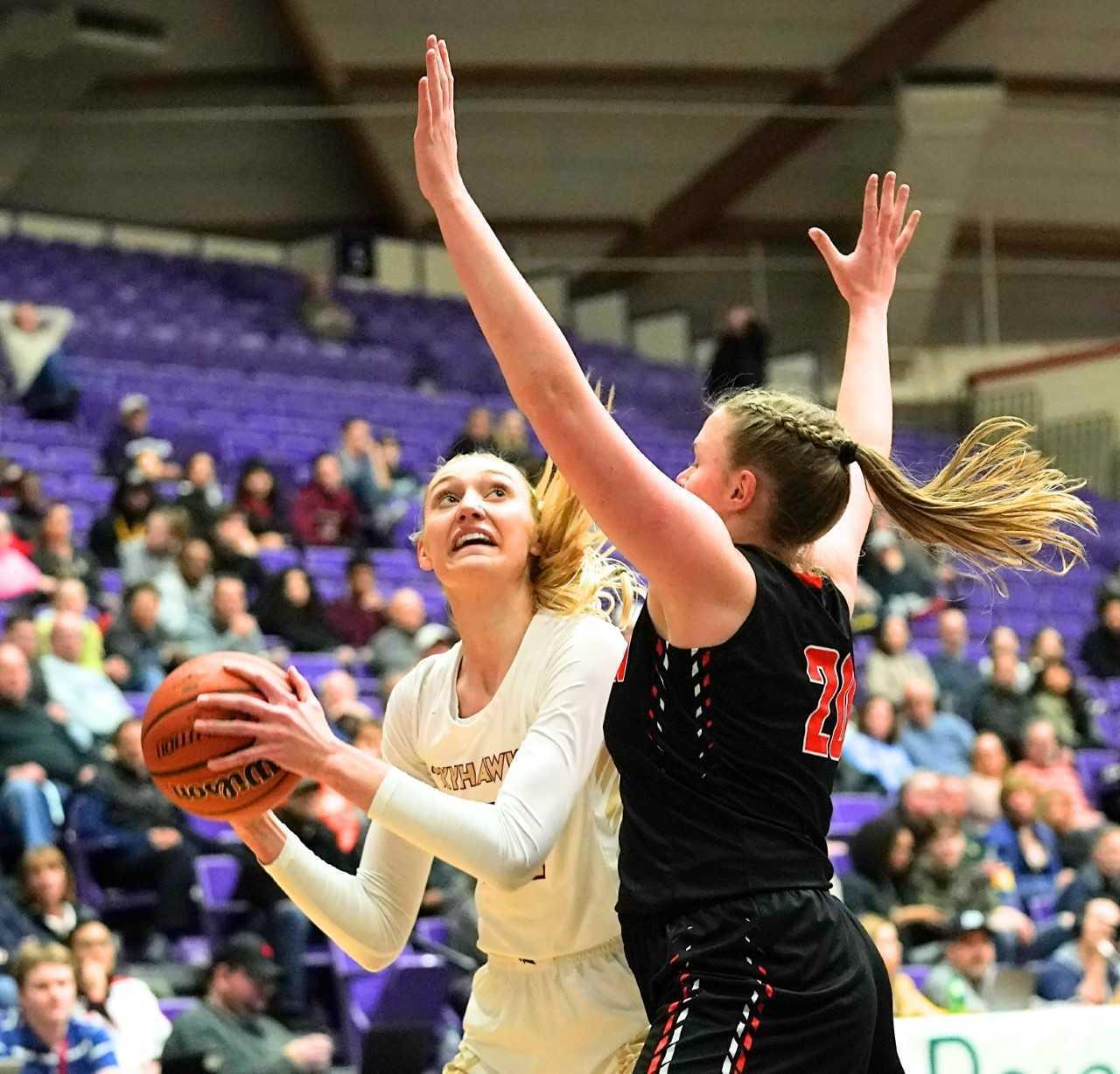 Southridge's Cameron Brink turns to shoot against Beaverton's Laura Erikstrup. (Photo by Jon Olson)