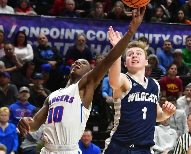 Churchill's Samaje Morgan (10) drives for a layup against Wilsonville's Gabe Reichle (1). (Photo by Joe Richter)