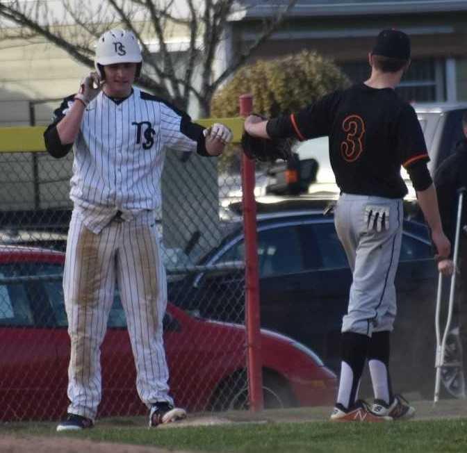 North Salem's Zach Goodwin (left) fist-bumps with Silverton's Caleb Ward. (Photo by Jeremy McDonald)