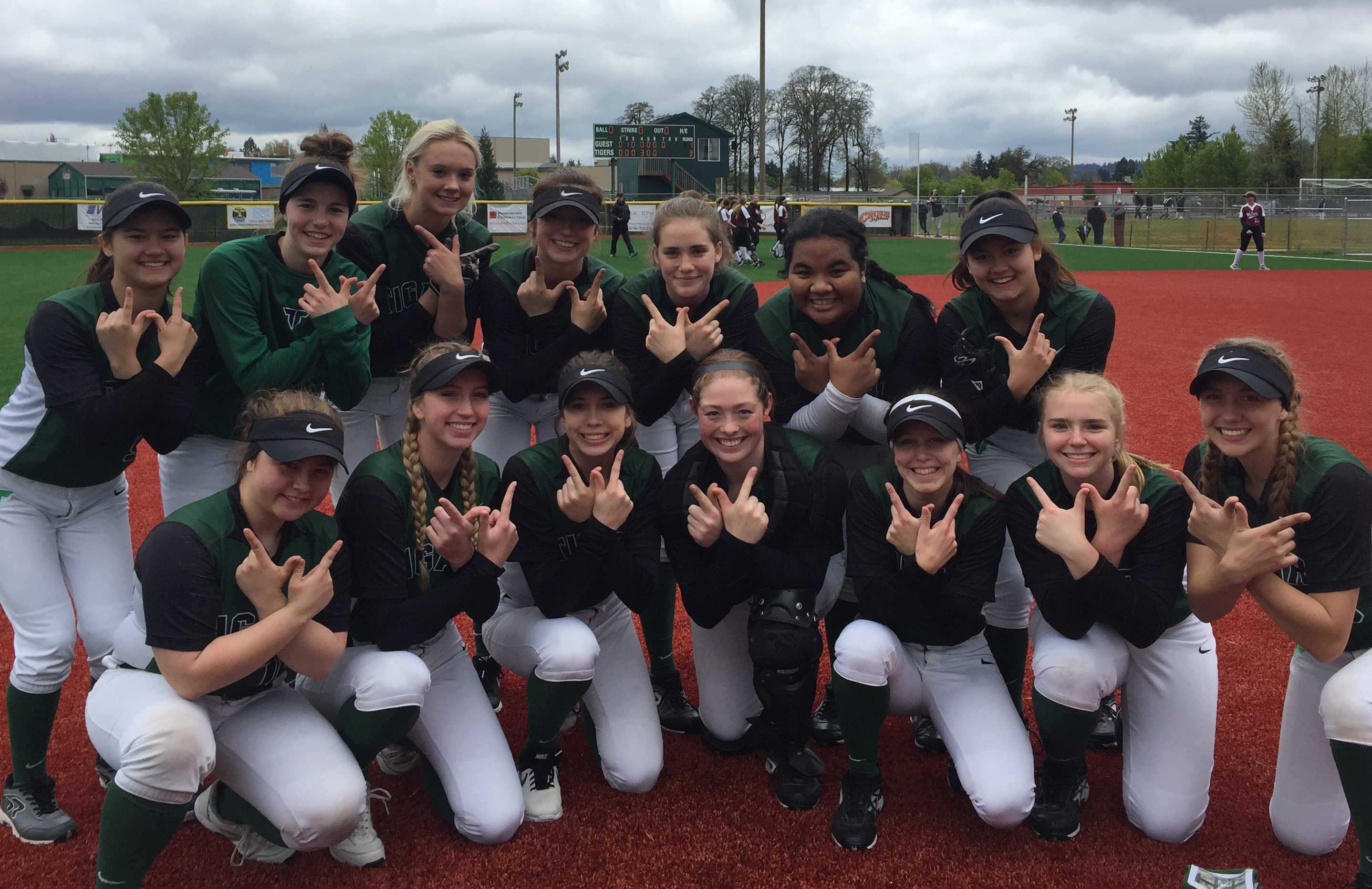 Tigard players pose after beating Tualatin on Saturday.