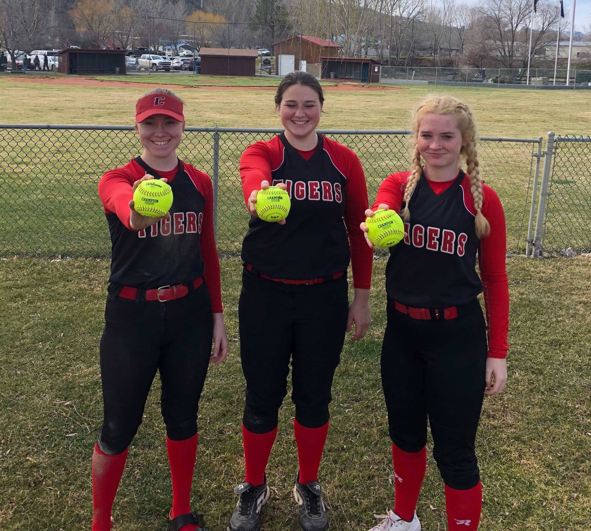Clatskanie's (from left) Alexis Smith, Kaity Sizemore and Sammie Hummer hit home runs in the same game. (Photo by Mary Sizemore)