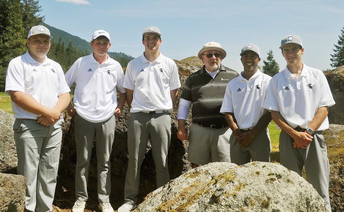 Marist's team, from left: Ben Proulx, Nick Watts, Alec Vendetti, coach Don Hanly, Arnav Reddy and Jared Charbonneau.