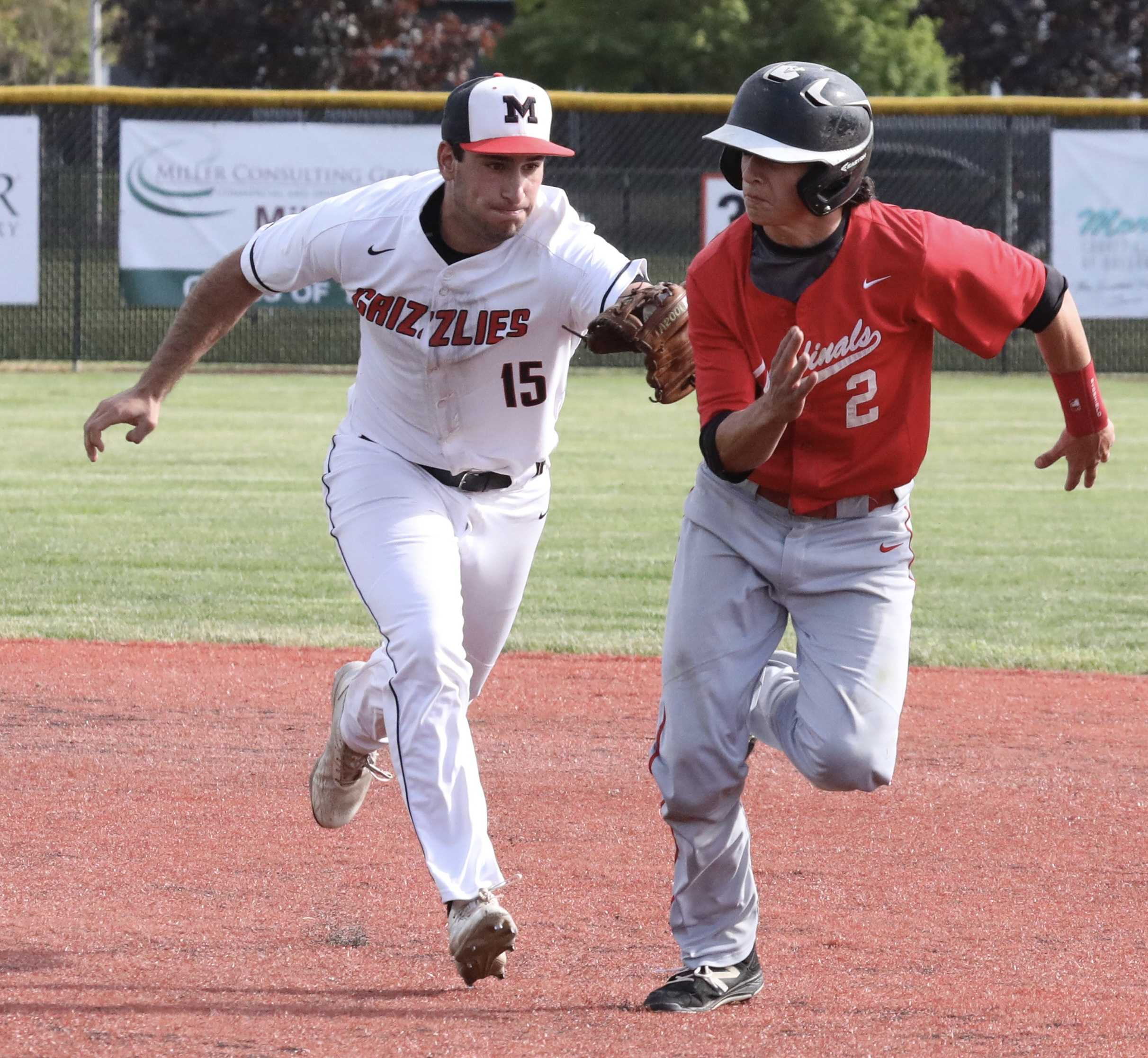 McMinnville second baseman Sam DuPuis tags out Lincoln's Kyle Gragnola on a successful pickoff play in the second inning.