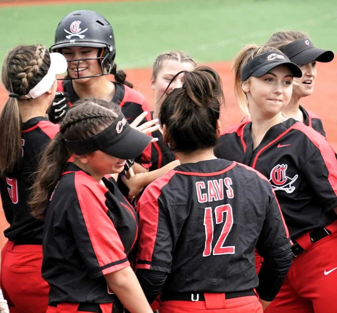 Clackamas players celebrate with Alyssa Daniell (helmet) after one of her two home runs. (Photo by Jon Olson)