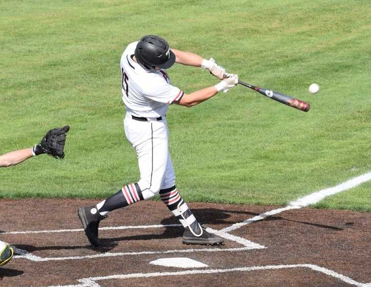 Thurston's Cade Crist connects for one of his two home runs. Photo by James Underwood