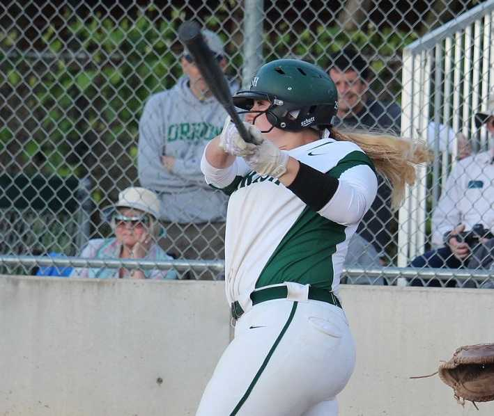 Sheldon's Olivia Schmidt goes yard. Photo by Tina Sams