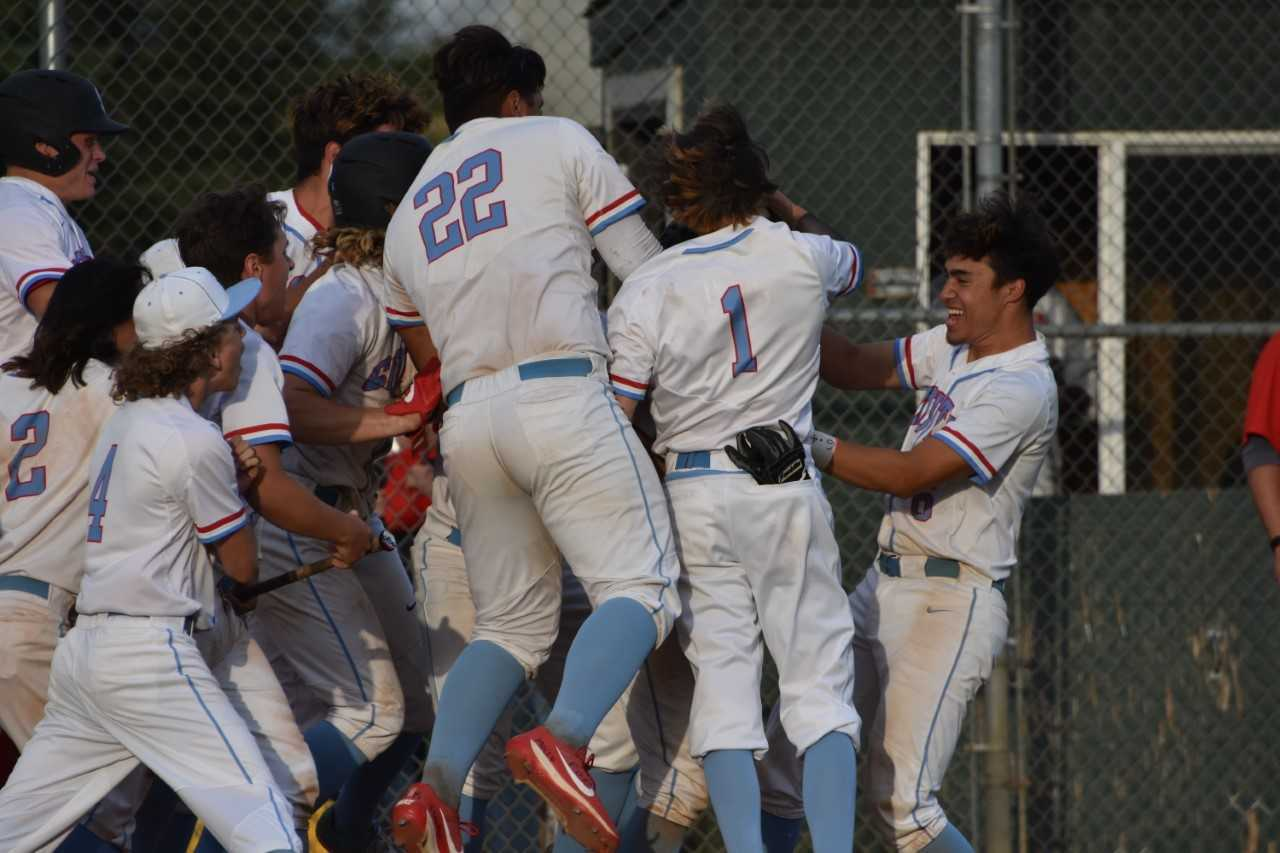 South Salem players swarm Kaiden Doten after his walk-off grand slam Wednesday. (Photo by Jeremy McDonald)