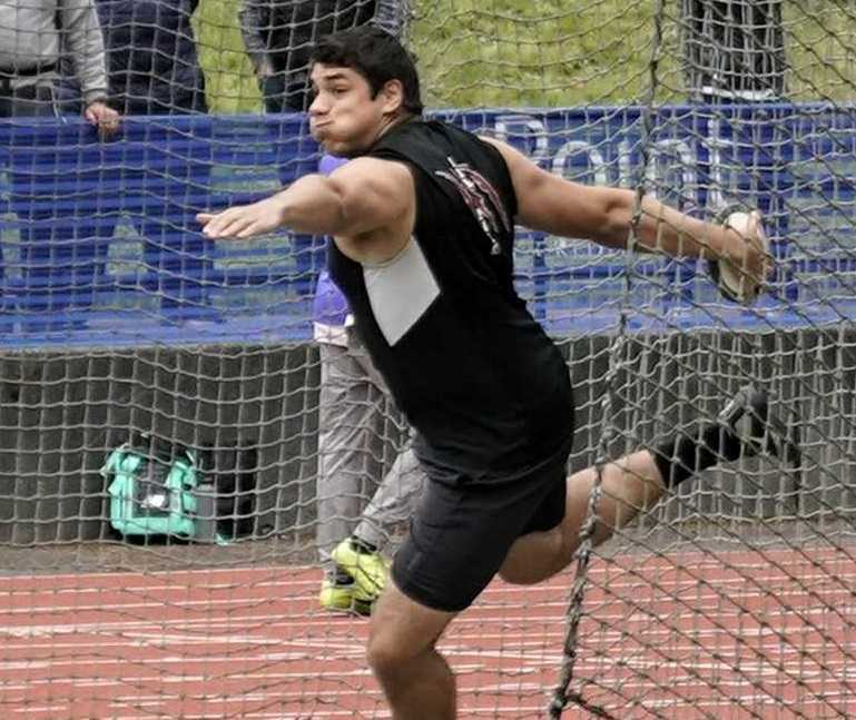 Mariano Kis won the shot and discus for Tualatin. (Photo by Jon Olson)