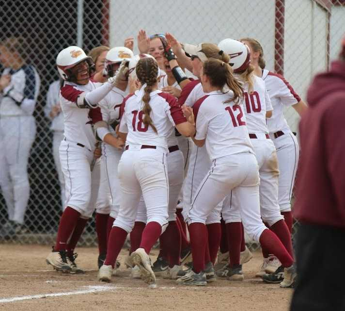 Junction City players celebrate Lindsey Stripling's home run against Marist Catholic. (Photo by Dawn Barth)