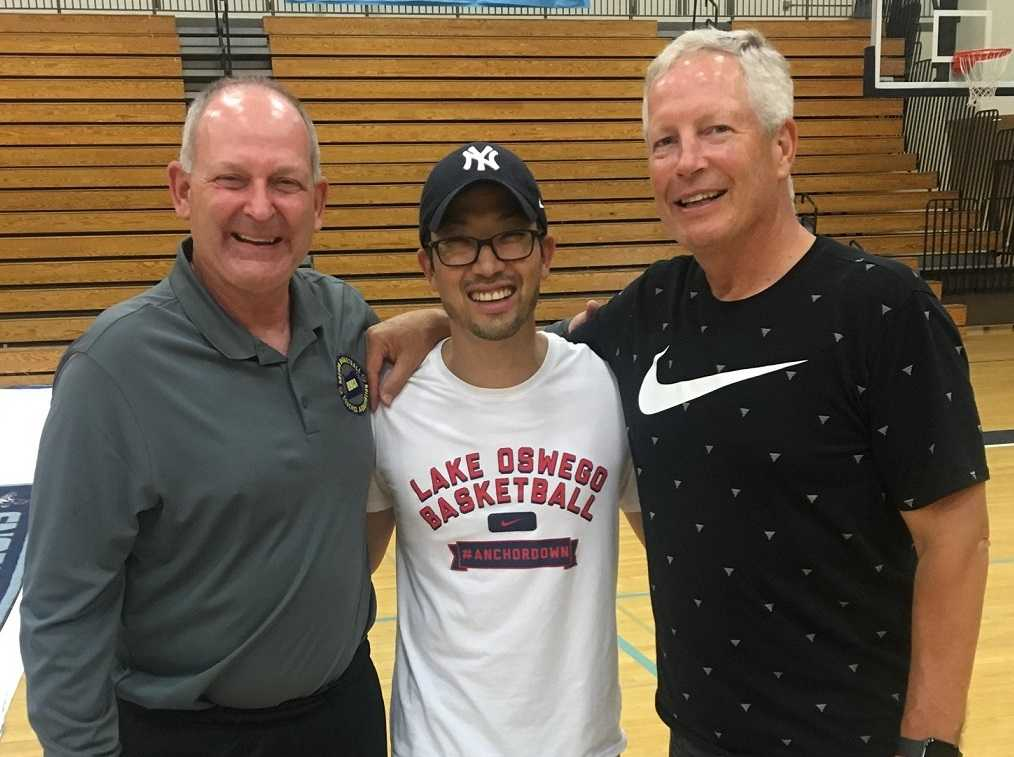 OBCA board members Roger Schenk (left) and Pat Coons (right) with Lake Oswego coach Marshall Cho.