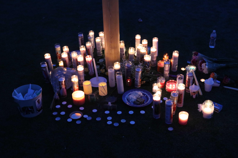 A candlelight memorial in honor of Santos and Bracken at Skyhawk Stadium. (Hunter Mann)