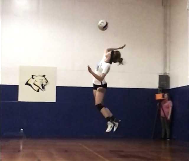 Jessica Carlisle of Alsea shows off her devastating jump serve